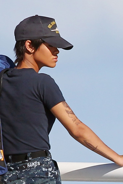 "Rihanna was on the set of her new music video ""Battleship"" with a new hairdo"